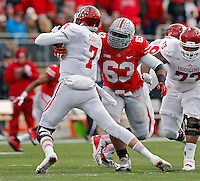 Ohio State Buckeyes defensive lineman Michael Bennett (63) sacks Indiana Hoosiers quarterback Nate Sudfeld (7) during the second quarter of their College football game at Ohio Stadium in Columbus, Ohio on November 23, 2013.  (Dispatch photo by Kyle Robertson)
