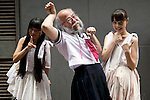 """July 20, 2013, Tokyo, Japan - The Japanese idol group """"Chaos de Japon"""" performance at Pasela Resorts Grande Shibuya on July 20, 2013. The middle-aged man """"GrowHair"""", who is producer and member of the junior-high schoolgirls idol group """"Chaos de Japon"""", wears a schoolgirl uniform (Sailor Suit) every weekend around Tokyo. He holds a Master in Mathematics from Waseda University and works in a printing company on weekdays. He started wearing the schoolgirl uniform in June 2011, because of a Ramen shop promotion for which people in a Sailor-suit could get free noodles. Mr. GrowHair joined the idol group """"Chaos de Japon"""" this March. During the performance he takes pictures and also dances and sings. (Photo by Rodrigo Reyes Marin/AFLO)"""