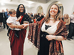 """Karen holds her nine-month-old daughter Doris as she dances with Jenn during their wedding reception. Jenn gave birth to the baby and Karen then had to legally adopt as a second parent. """"There were a couple of months of her life when there was not a legal mother,"""" Jenn Kali said."""