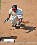 6 September 2009: Cleveland Indians' outfielder Michael Brantley dives savely back to first during a game against the Minnesota Twins at Progressive Field in Cleveland, Ohio. The Indians defeated the Twins 3-1 to take the rubber match of their three-game weekend series. Mandatory Credit: Ed Wolfstein Photo