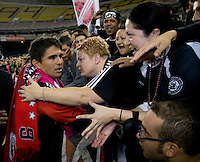 Jamie Moreno (99) of D.C. United meets with members of Barra Brava after his last game at RFK Stadium in Washington, DC.  Toronto defeated D.C. United, 3-2.