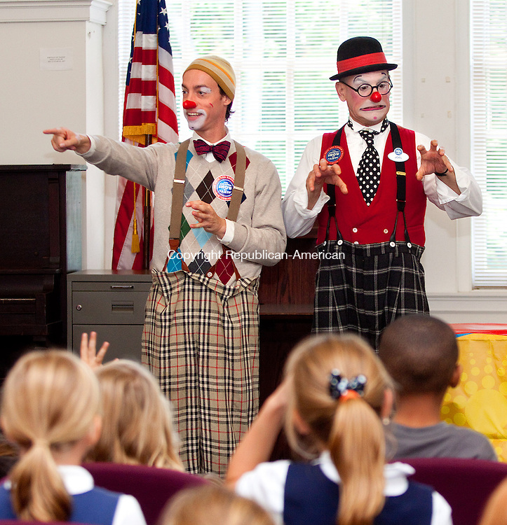 DERBY CT- SEPTEMBER 20 2011 -092812DA01- Ringling Bros. and Barnum & Bailey's clowns Watson Kawecki , left, and  Joel Jeske performed and read Olivia Saves the Circus by Ian Falconer to nearby elementary students during story time at the Derby Public Library on Thursday. Ringling Bros. and Barnum & Bailey will present their all-new surge of circus entertainment, Fully Charged performance at Webster Bank Arena in Bridgeport Oct. 18th. For more information, visit www.Ringling.com..Darlene Douty Republican-American