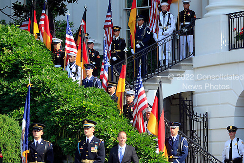 An honor guard awaits the arrival of German Chancellor Angela Merkel at the White House in Washington, D.C., U.S., on Tuesday, June 7, 2011. .Credit: Andrew Harrer / Pool via CNP