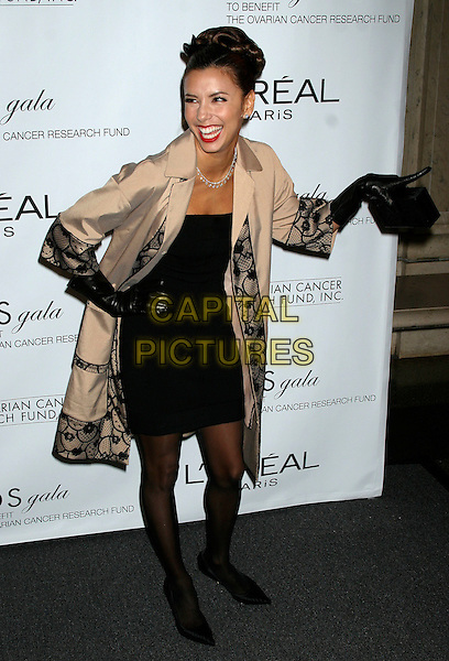 EVA LONGORIA.The L'Oreal Legends Gala Benefit For Ovarian Cancer Research Fund at the American Museum of Natural History, New York, NY, USA..November 8th, 2006.Ref: IW.full length black dress gloves beige cream jacket black pattern trim design hand on hip laughing pointing.www.capitalpictures.com.sales@capitalpictures.com.©Ian Wilson/Capital Pictures