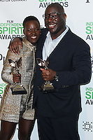 SANTA MONICA, CA, USA - MARCH 01: Lupita Nyong'o, Steve McQueen in the press room during the 2014 Film Independent Spirit Awards held at Santa Monica Beach on March 1, 2014 in Santa Monica, California, United States. (Photo by Xavier Collin/Celebrity Monitor)