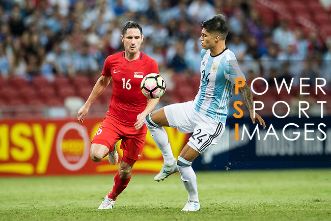 Carlos Correa of Argentina (R) in action against Daniel Bannett of Singapore (L) during the International Test match between Argentina and Singapore at National Stadium on June 13, 2017 in Singapore. Photo by Marcio Rodrigo Machado / Power Sport Images