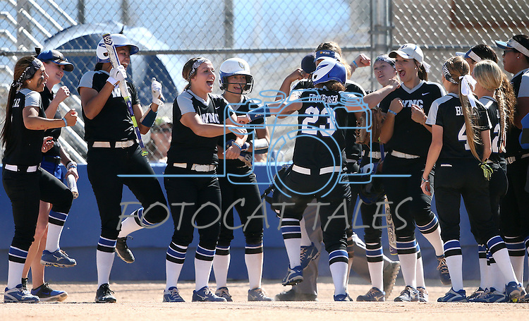 Western Nevada's Kacie Freudenberger celebrates a 2-run homer against College of Southern Nevada at Edmonds Sports Complex in Carson City, Nev., on Friday, April 1, 2016. <br />