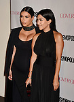 WEST HOLLYWOOD, CA - OCTOBER 12: TV personalities Kim Kardashian and Kourtney Kardashian arrive at Cosmopolitan Magazine's 50th Birthday Celebration at Ysabel on October 12, 2015 in West Hollywood, California.