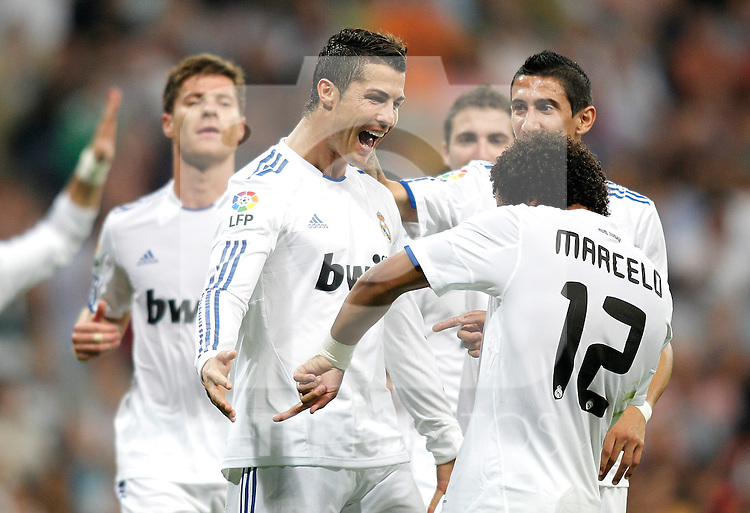 Real Madrid's Cristiano Ronaldo celebrates with Marcelo during La liga match. September 21, 2010. (ALTERPHOTOS/Alvaro Hernandez).