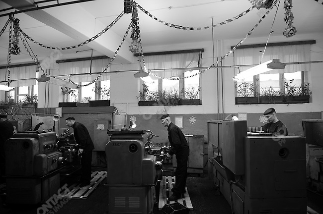 Prisoners work at lathes in one of the prison's many workshops.  The workshops provide skills for the prisoners and their work is sold by the prison for money, part of which is passed back to the prisoners. Prison colony #7 outside of Novgorod in the Novgorod region south of St. Petersburg, Russia, December 15, 2008.