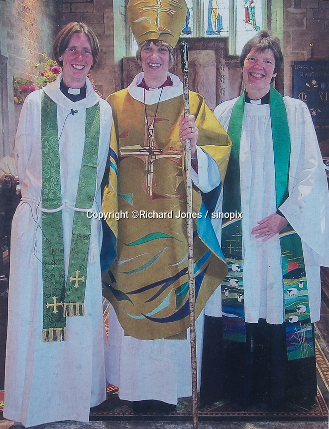 Rev. Katrina Scott (left), of St Mary's Church in Lower Slaughter, Cotswolds, Gloucestershire, 19th July 2016. Chinese couples often use the church for wedding photos. An increasing number of Chinese couple are having their wedding photos taken in the English country-side, classic towns and monuments to show in China. <br /> <br /> Photo by Richard Jones/Sinopix