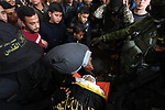 Relatives of the Palestinian Jihad Harara, 23, who was shot dead by Israeli forces during clashes with Israeli troops in tents protest where Palestinians demand the right to return to their homeland at the Israel-Gaza border, mourn over his body during his funeral in Gaza City, on March 23, 2019. Photo by Mahmoud Ajjour