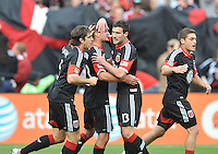 Perry Kitchen (23) of D.C. United celebrates his score with teammates in the 17th minute of the match. The Philadelphia Union defeated D.C. United 3-2, at RFK Stadium, Sunday April 21, 2013.