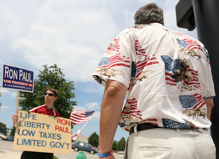 Supporters for Presidential hopeful Ron Paul demonstrate in front of location holding the Iowans for Tax Relief and Iowa Christian Alliance presidential forum in Des Moines, Iowa June 30, 2007. Paul was not an invited speaker.