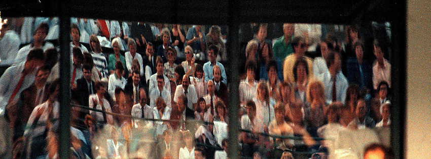 Photo. Steve Holland.Wimbledon Championship, London. 1988.Wimbledon crowd reflection
