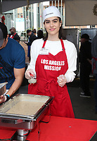 21 December 2018 - Los Angeles, California - Amelia Hamlin. Los Angeles Mission Christmas Meal for the Homeless held at Los Angeles Mission. Photo Credit: F. Sadou/AdMedia