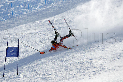 20 February 2006: Swiss skier Daniel Albrecht (SUI) slides down the mountain on his back after falling during his first run in the Men's Giant Slalom at the Sestriere sub-area Colle during the 2006 Turin Winter Olympics. Photo: Neil Tingle/actionplus..060220 torino male man men ski skiing snow crash fall
