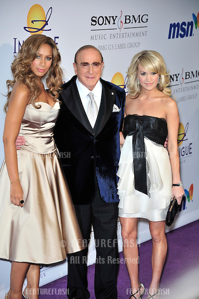 LtoR: Leona Lewis, Clive Davis & Carrie Underwood at music mogul Clive Davis' annual pre-Grammy party at the Beverly Hilton Hotel..February 9, 2008  Los Angeles, CA.Picture: Paul Smith / Featureflash