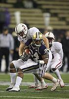 Oct 30, 20010:  Washington kick returner #24 Jesse Callier gets wrapped up by Stanford's #44 Chase Thomas.  Stanford defeated Washington 41-0 at Husky Stadium in Seattle, Washington. J.