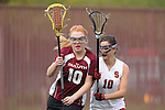 Santa Barbara, CA 02/19/11 - Callie Good (Minnesota-Duluth #10) and Victoria Fischman (Stanford #10) in action during the Stanford - Minnesota-Duluth game at the 2011 Santa Barbara Shootout.