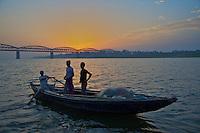 Fishing boat and sunrise over the Ganges River Varanasi India