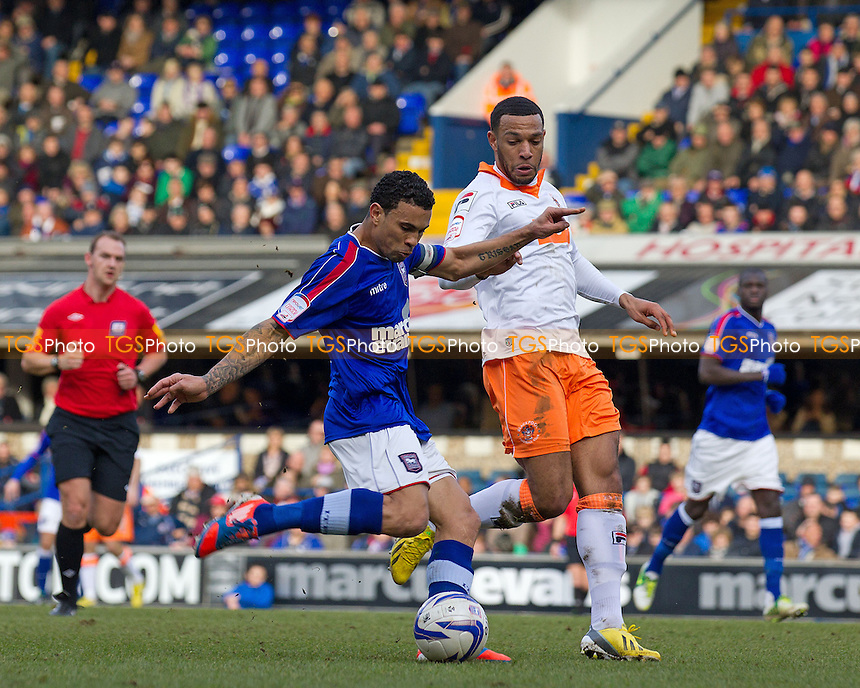 Carlos Edwards, Ipswich Town FC prepares to take a strike at goal under pressure from Matt Phillips, Blackpool FC - Ipswich Town vs Blackpool - NPower Championship Football at Portman Road, Ipswich, Suffolk - 16/02/13 - MANDATORY CREDIT: Ray Lawrence/TGSPHOTO - Self billing applies where appropriate - 0845 094 6026 - contact@tgsphoto.co.uk - NO UNPAID USE.