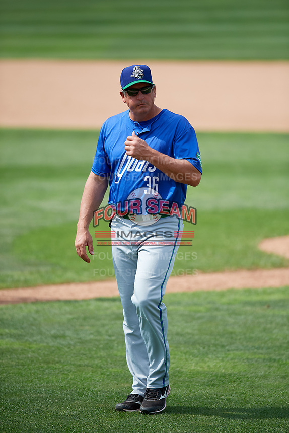 Hartford Yard Goats pitching coach Dave Burba (36) walks back to the dugout during a game against the Erie SeaWolves on August 6, 2017 at UPMC Park in Erie, Pennsylvania.  Erie defeated Hartford 9-5.  (Mike Janes/Four Seam Images)