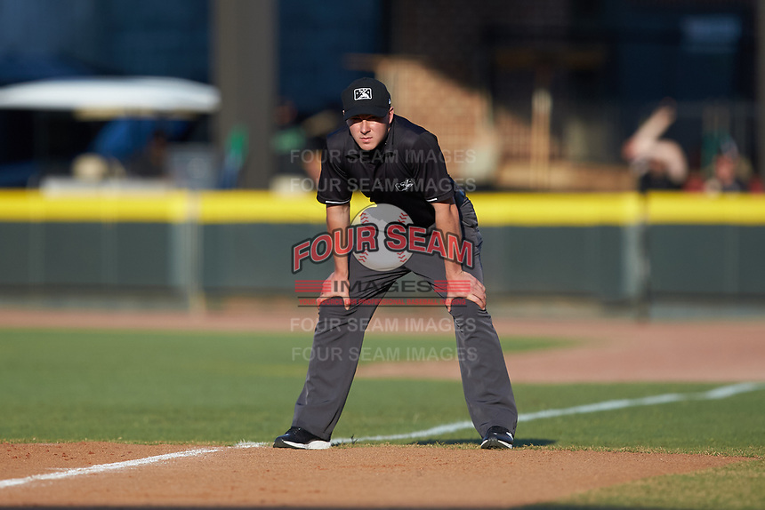 Umpire Steven Jaschinski handles the calls on the bases during the Carolina League game between the Carolina Mudcats and the Winston-Salem Dash at BB&T Ballpark on June 1, 2019 in Winston-Salem, North Carolina. The Mudcats defeated the Dash 6-3 in game one of a double header. (Brian Westerholt/Four Seam Images)