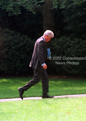 United States President Bill Clinton walks back to the Oval Office of the White House in Washington, D.C. after his visit to Brook Grove Elementary School on September 7, 1999..Credit: Ron Sachs / CNP