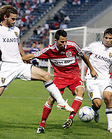 Real Salt Lake midfielder Kyle Beckerman (5) and defender Tony Beltran (2) collapse around Chicago Fire midfielder Marco Pappa (16).  The Chicago Fire defeated Real Salt Lake 1-0 at Toyota Park in Bridgeview, IL on August 1, 2009.