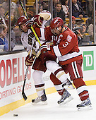 Ben Smith (BC - 12), Alex Biega (Harvard - 3) - The Boston College Eagles defeated the Harvard University Crimson 6-0 on Monday, February 1, 2010, in the first round of the 2010 Beanpot at the TD Garden in Boston, Massachusetts.