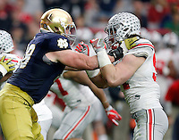 Ohio State Buckeyes defensive lineman Joey Bosa (97) takes on Notre Dame Fighting Irish offensive lineman Mike McGlinchey (68) in the first quarter during the Fiesta Bowl in the University of Phoenix Stadium on January 1, 2016.  (Dispatch photo by Kyle Robertson)