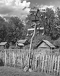 Gourd birdhouses rise above the garden at the Oconaluftee Mountain Farm Museum. HDR Black and White image combining three separate images.