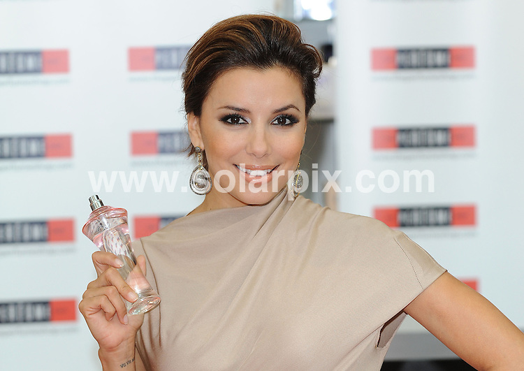 **ALL ROUND PICTURES FROM SOLARPIX.COM**.**WORLDWIDE SYNDICATION RIGHTS**.Eva Longoria Parker - photocall and fragrance signing. Desperate Housewives star meets the fans to promote the UK launch of her new fragrance Eva. Held at The Perfume Shop, Westfield Shopping Centre. London W12, on Sunday September 05, 2010..This pic: Eva Longoria Parker..JOB REF: 12032 SSD DATE: 05.09.10.**MUST CREDIT SOLARPIX.COM OR DOUBLE FEE WILL BE CHARGED**.**MUST NOTIFY SOLARPIX OF ONLINE USAGE**.**CALL US ON: +34 952 811 768 or LOW RATE FROM UK 0844 617 7637**