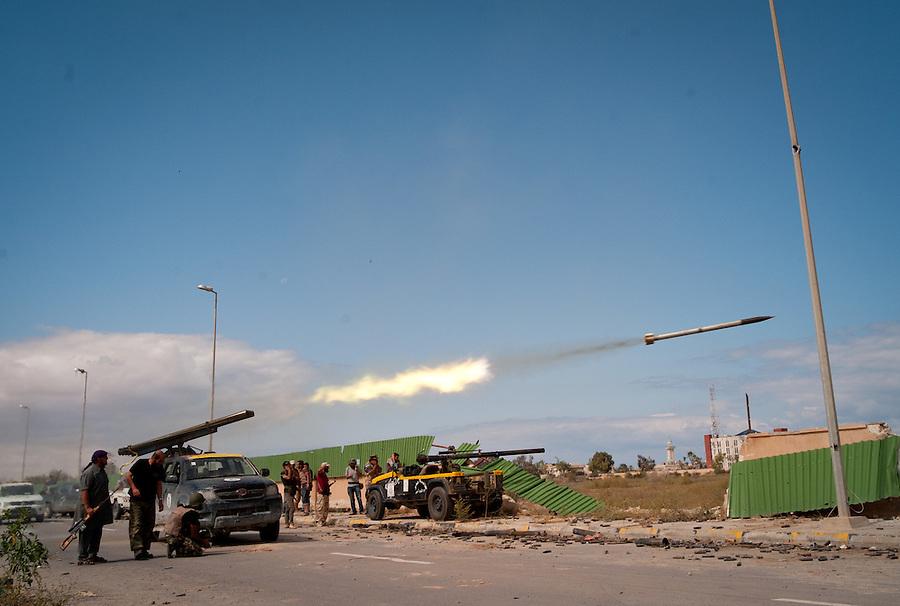 Anti-Gaddafi fighters fire Grad rockets towards Gaddafi loyalist positions in Sirte, Libya.