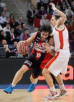 Caja Laboral Baskonia's Fernando San Emeterio (l) and CAI Zaragoza's Chad Toppert during Spanish Basketball King's Cup match.February 07,2013. (ALTERPHOTOS/Acero)