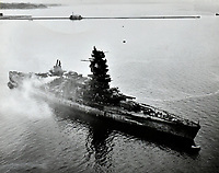 The badly damaged Japanese battleship Nagato sits near Yokosuka Naval Air Station near Tokyo, Japan. The Shangri-La's air group beat it up on July 18, 1945  -  Photo taken Aug. 26, 1945<br /> <br /> Photo by Wade Litzinger or R.J. Guttosch
