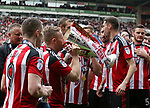 Sheffield United's Mark Duffy drinks from the trophy during the League One match at Bramall Lane, Sheffield. Picture date: April 30th, 2017. Pic David Klein/Sportimage
