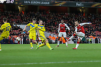 Jack Wilshere of Arsenal (right) scores his team's third goal of the game to make the score 3-0 during the UEFA Europa League match between Arsenal and FC BATE Borisov  at the Emirates Stadium, London, England on 7 December 2017. Photo by David Horn.