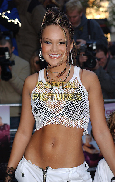 ZOE BIRKETT.Atending the Gala Celebrity Premiere of movie Seeing Double at the Odean Cinema, Leicester Square, London..April 7th 2003.half length half-length white string vest over black bra boobs cleavage tummy mid-riff belly .Ref: BEL.www.capitalpictures.com.sales@capitalpictures.com.©Capital Pictures