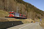 Train line running parallel with a road in the Swiss alps. Between Brig and Oberwald in Switzerland.
