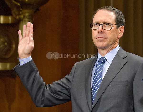 "Randall Stephenson, Chairman & Chief Executive Officer AT&T, is sworn-in to testify before the United States Senate Committee on the Judiciary Subcommittee on Antitrust, Competition Policy & Consumer Rights hearing ""Examining the Competitive Impact of the AT&T-Time Warner Transaction"" on Capitol Hill in Washington, DC on Wednesday, December 7, 2016.<br /> Credit: Ron Sachs / CNP /MediaPunch"
