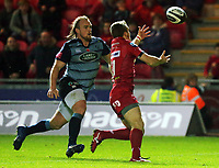 Jonathan Evans of the Scarlets (R) grabs the ball while closely followed by Kristian Dacey of Cardiff Blues to go on and score a try during the Guinness PRO14 match between Scarlets and Cardiff Blues at Parc Y Scarlets Stadium, Llanelli, Wales, UK. Saturday 28 October 2017