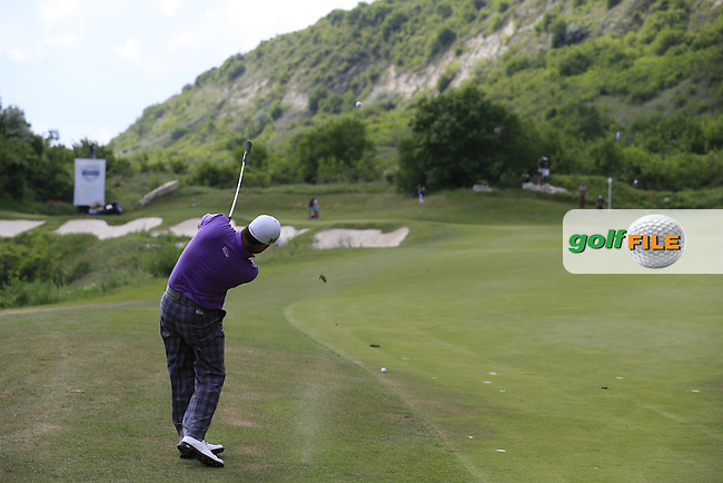 Graeme McDowell (NIR) plays his 2nd shot on the 11th hole during Saturday Afternoon's Quarter Finals of the 2013 Volvo World Matchplay Championship held  at the Thracian Cliffs Golf & Beach Resort, Kavarna, Bulgaria, 18th May 2013..Picture: Eoin Clarke www.golffile.ie.