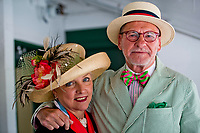 LOUISVILLE, KY - MAY 05: A man and a woman both pose for a photo while wearing their fancy hats on Kentucky Oaks Day at Churchill Downs on May 5, 2017 in Louisville, Kentucky. (Photo by Douglas DeFelice/Eclipse Sportswire/Getty Images)