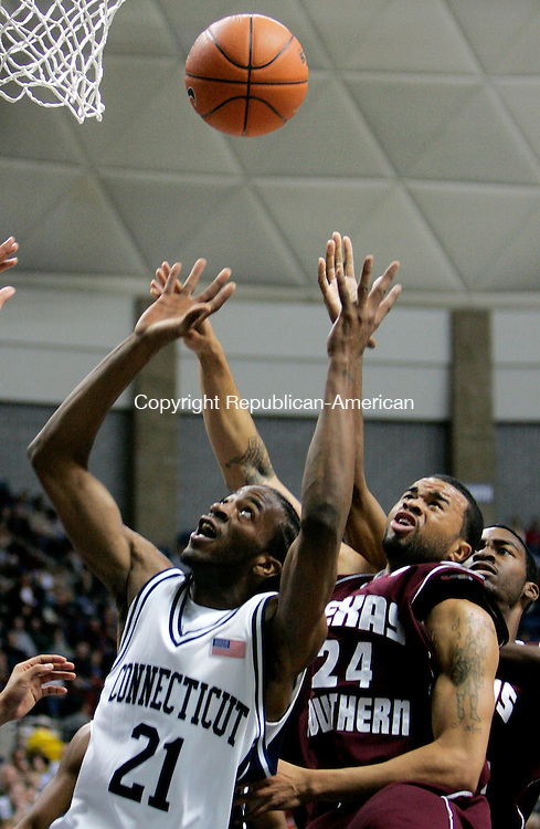 STORRS, CT. 03 December 2006--120306SV03--#21 Stanley Robinson of UConn goes up for the rebound against #24 Leonta Matthews of Texas Southern during basketball action at Gampel Pavilion in Storrs Sunday. Steven Valenti Republican-American