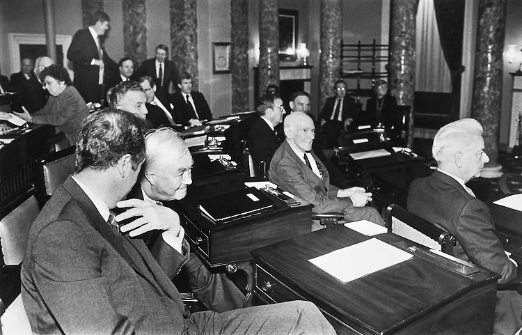 Front Row Left to Right: Johnson, Sen. George John Mitchell, D-Maine, Alan Cranston, Sen. Robert Byrd, D-W. Va. Second Row Left to Right: Sarbarus, Sen. Daniel Patrick Moynihan, D-N.Y., and Sen. Bill Bradley, D-N.J., (conferring). December 11, 1988 (Photo by CQ Roll Call)