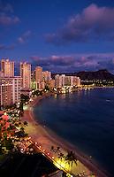 Waikiki Beach at twilight, with Diamond Head Crater on right, Honolulu, Oahu, Hawaii USA.