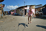 "THIS PHOTO IS AVAILABLE AS A PRINT OR FOR PERSONAL USE. CLICK ON ""ADD TO CART"" TO SEE PRICING OPTIONS.   A boy skips rope in Suto Orizari, Macedonia. The mostly Roma community, located just outside Skopje, is Europe's largest Roma settlement. ."