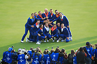 Winning team Europe on the 18th green starting their celebrations after the sunday singles at the Ryder Cup, Le Golf National, Paris, France. 30/09/2018.<br /> Picture Phil Inglis / Golffile.ie<br /> <br /> All photo usage must carry mandatory copyright credit (&copy; Golffile | Phil Inglis)